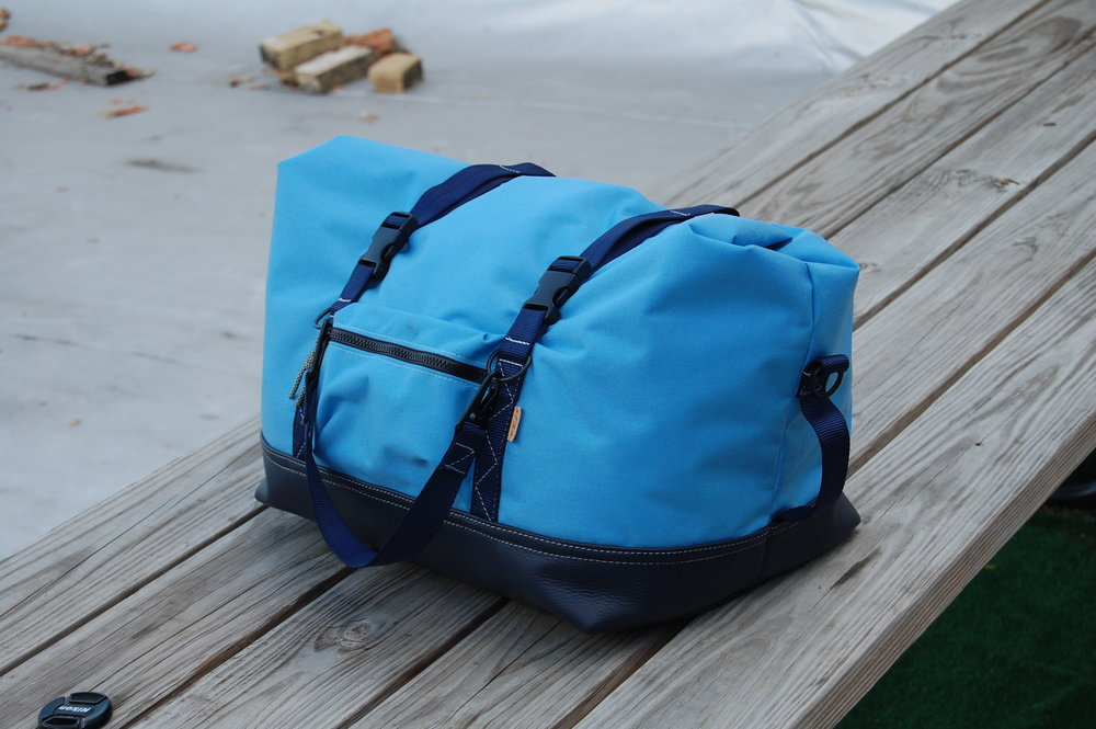 Roll top duffle in 1000D Cordura and leather.