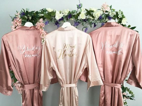 Robes! - When we arrive to a Bridal Party to start Hair and Makeup the Robes are always adorable. We have seen Flannel, Gold, Even Pumpkins with veils. These blush and rose gold robes are beyond amazing.