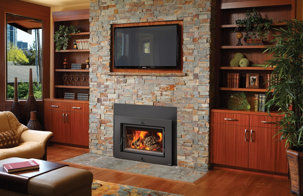 Fireplace Xtrordinair Wood Burning Contemporary Flush-Faced Styled Inserts can be inserted into existing fireplaces.