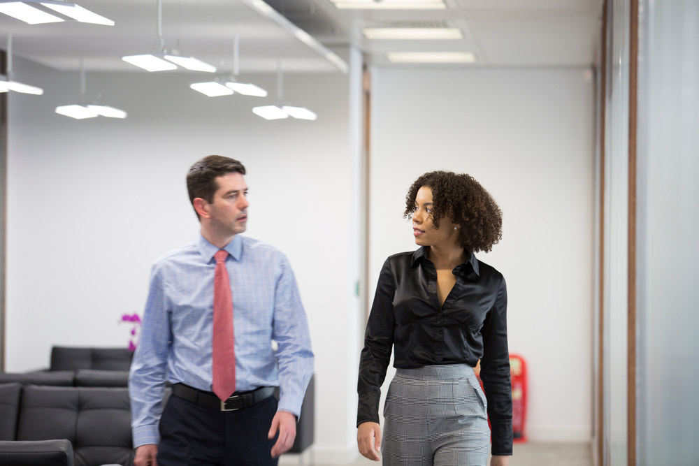 walking couple in an office.jpg