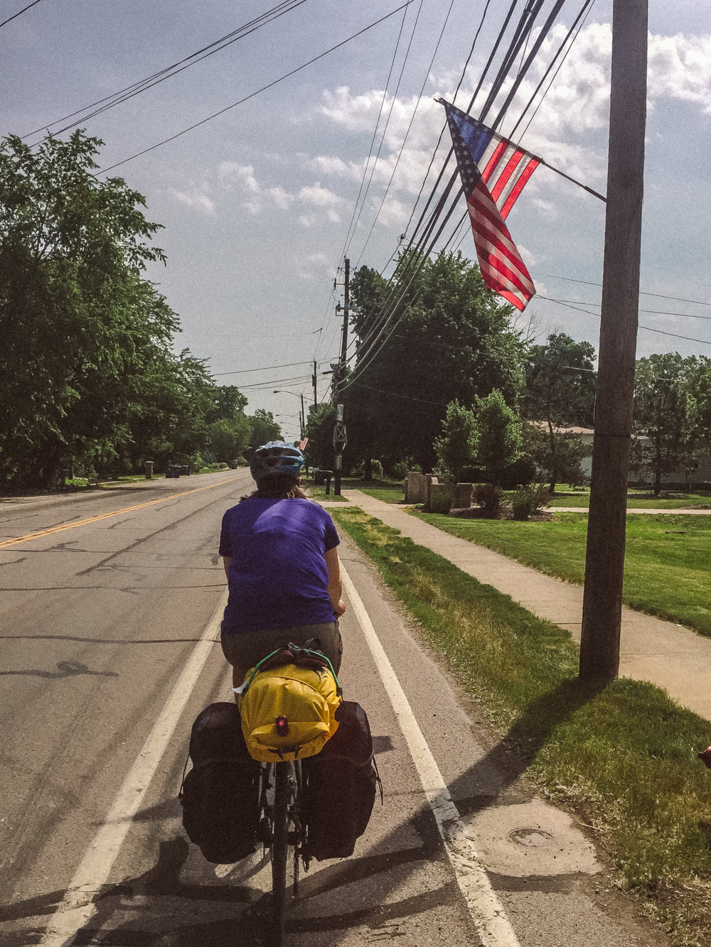 Joelle rocking life in the bumpy, crusty bike lane. Vermillion, OH