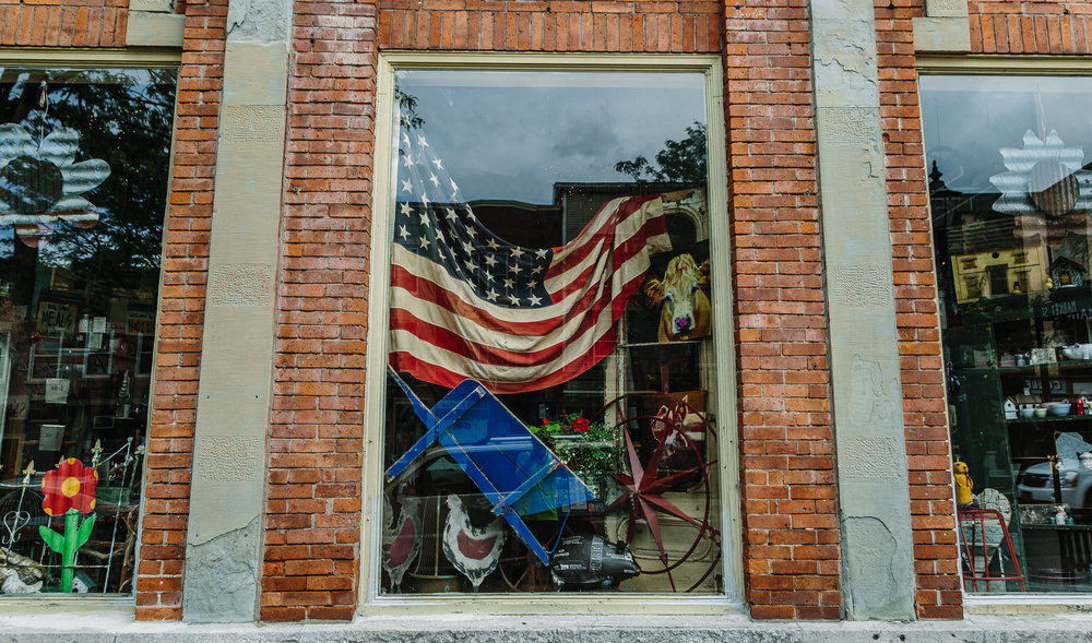 A store window in downtown Brockport. After battling down the Erie Canal trail (think pedaling on wet kitty litter and you're on the right track for the condition of this trail) we stopped for coffee. Brockport, NY