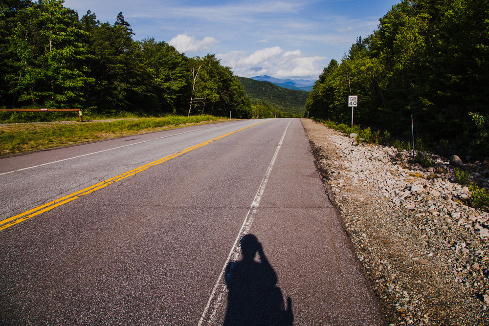 This question raises a lot of questions. 1. Where does the road go? That 12% grade makes thing difficult to see. 2. Do bikes have to abide by the speed limit? Because, if so, Joelle deserves a speeding ticket. Appalachian Trail, NH