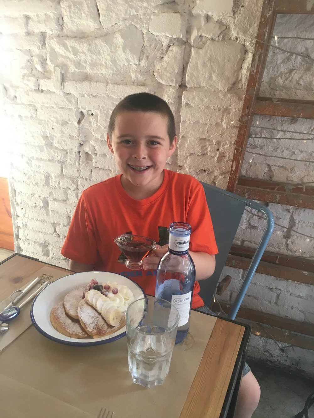 The 9-year-old loving his sugar-dusted pancakes
