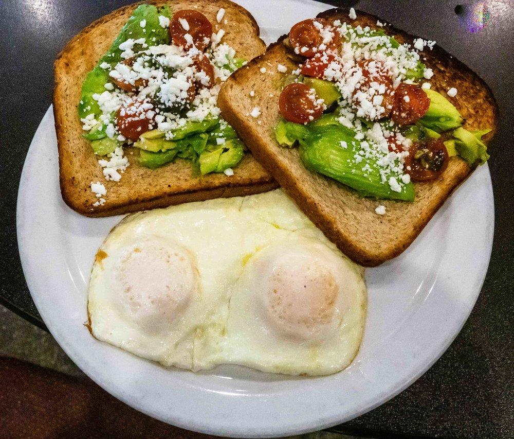 Avocado toast with eggs over easy