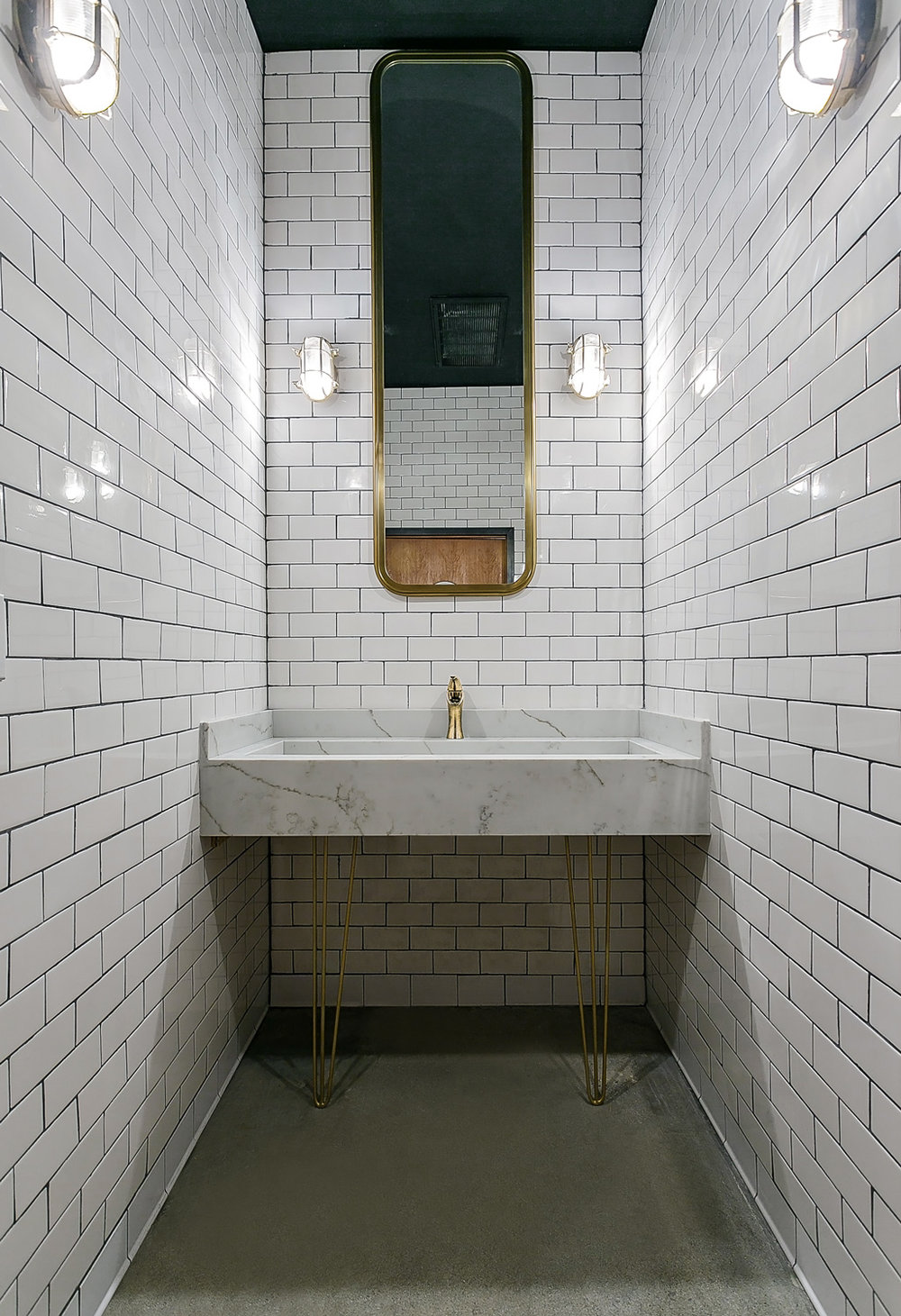 melrose-station-speakeasy-bar-in-hollywood-by-archillusion-design-los-angeles-restroom-custom-marble-sink-midcentury