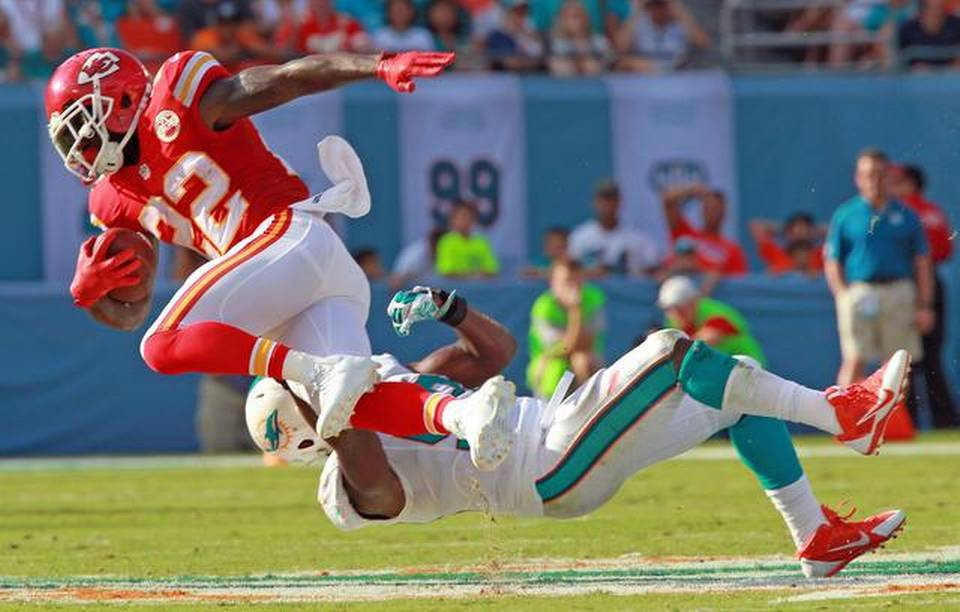 The Dolphins had no answers for the Chiefs on either side of the ball. Above Joe McKnight (22) catches a pass for a first down.