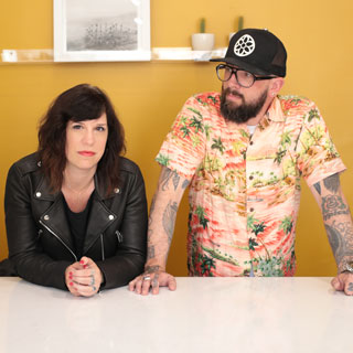 Ben Neuhaus & Miranda Malloy - Ben and Miranda are co-owners of Snake Oil Provisions (est. 2013) and Snake Eyes Society (est. 2018) men's and women's retail shops in Long Beach, California. They met in 2009 in Atlanta, Georgia. As it turns out, they grew up less than 2 miles from each other but met many years later thanks to Match.com. A series of pivotal experiences led them to set their sights on Long Beach, where they officially landed in late 2012 and launched Snake Oil Provisions online a few months later. By late summer 2013, SOP's first brick and mortar store opened for business. Almost five years later, Ben and Miranda's shops are located steps from each other in Downtown Long Beach's East Village Arts District.Snake Oil Provisions • Snake Eyes Society