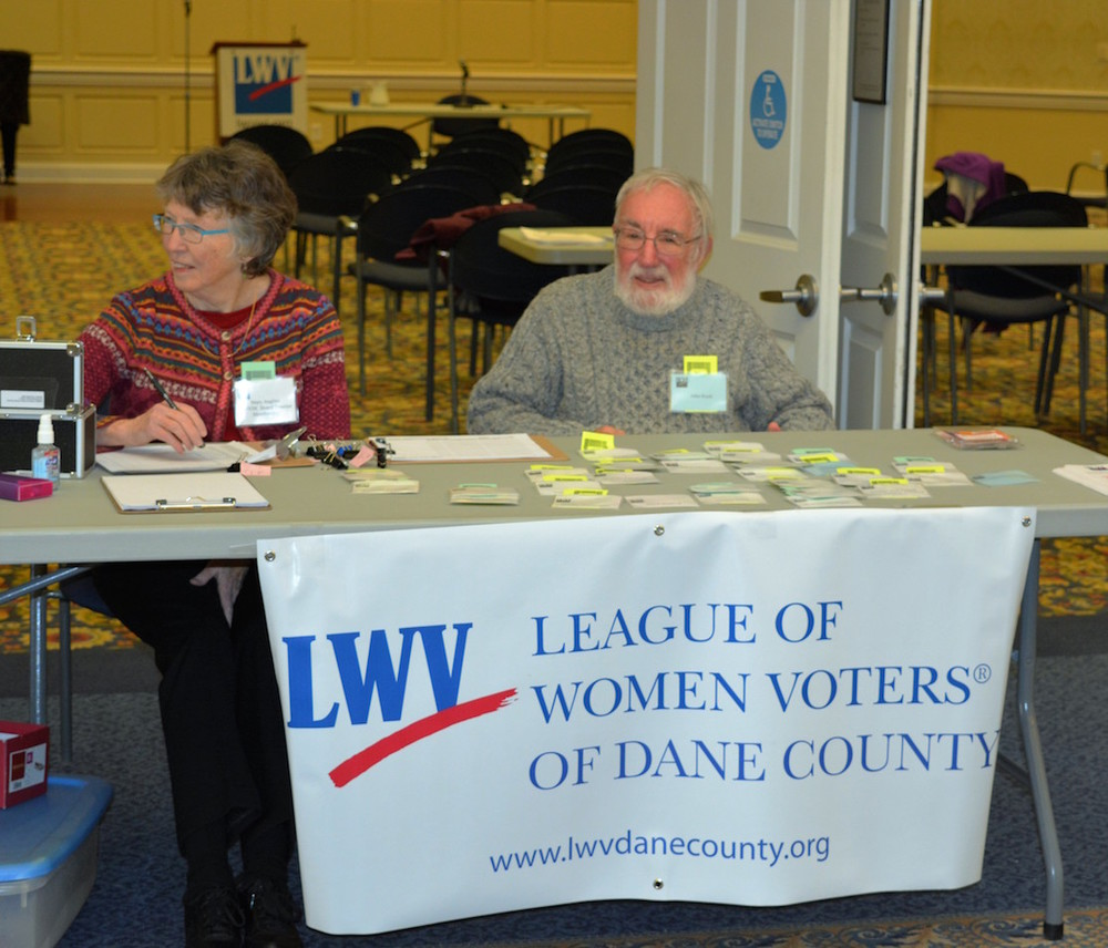Mary Anglim and John Koch registered members and guests for the Lively Issues Luncheon.