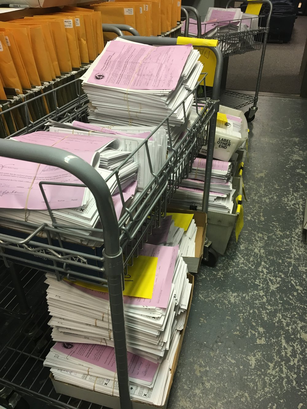 Packets of in-person absentee ballots (with their lilac chain of custody declarations attached) in the vault at the City Clerk's office. (Photo courtesy of Maribeth Witzel-Behl.)
