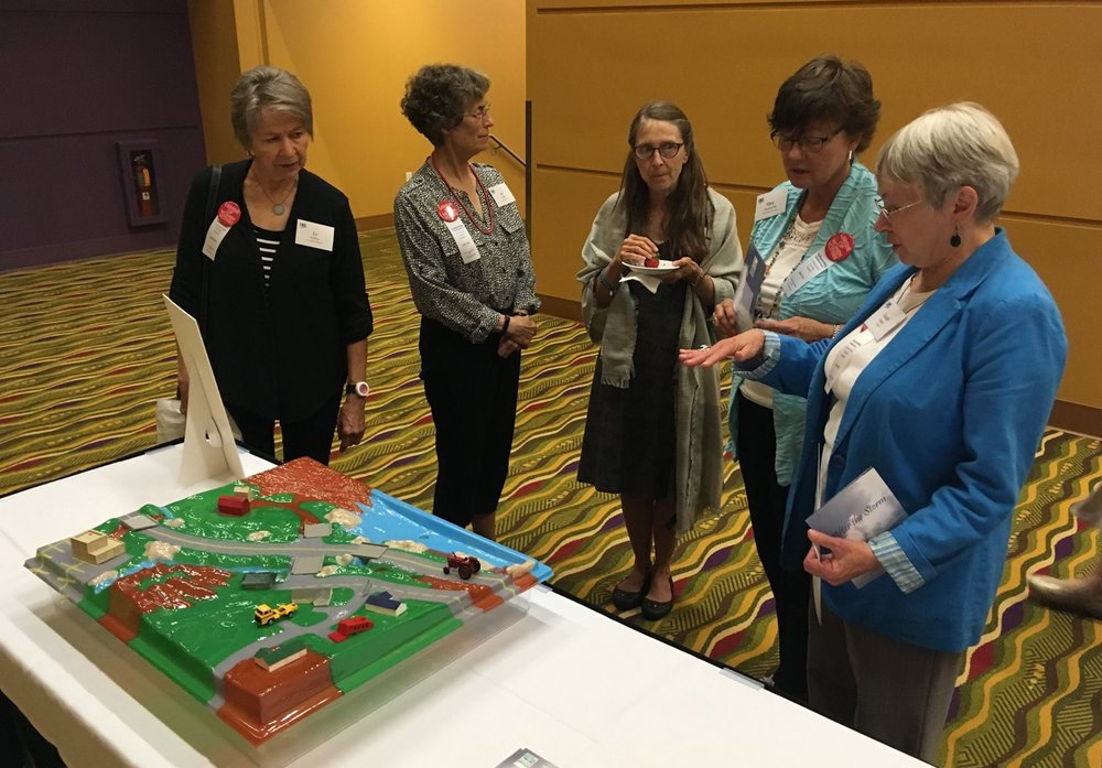 Members explore the Watershed game.