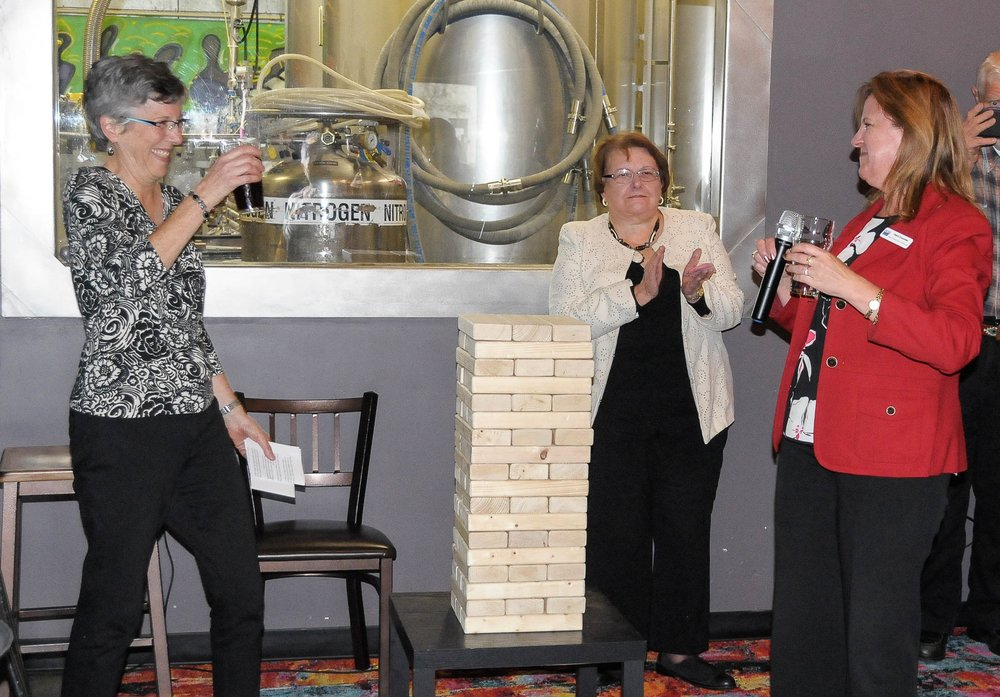 LWVWI Executive Director Andrea Kaminski raises a glass to Debra Cronmiller, LWVWI President, and Melanie Ramey, past President, at her retirement party, October, 2017