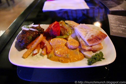 Beef Tikka, Bombay Fries, Coconut Kurma, Chutney and Garlic Naan at Karma