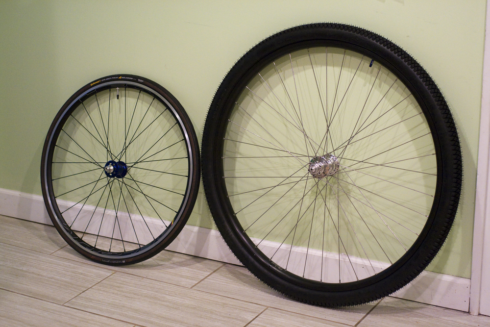 700c road wheel on the left 36er on the right.