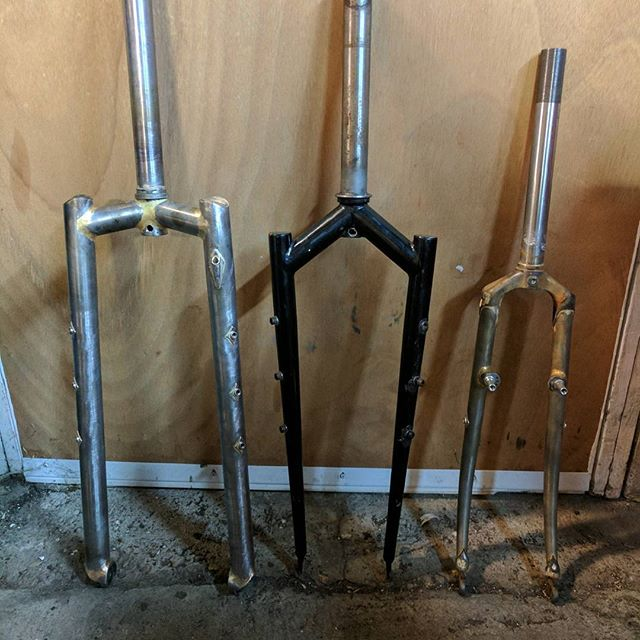 Three #26inch forks.  Two #fatbike forks and one road fork. The fork on the left is to replace the fork in the middle, and the fork on the right is for a new build. #steelisreal #custombike