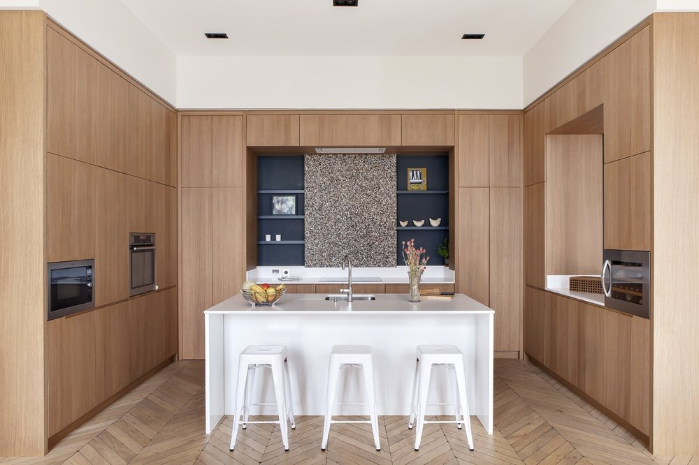 paris-apartment-wood-kitchen-parquet-floor-white-island-1.jpg