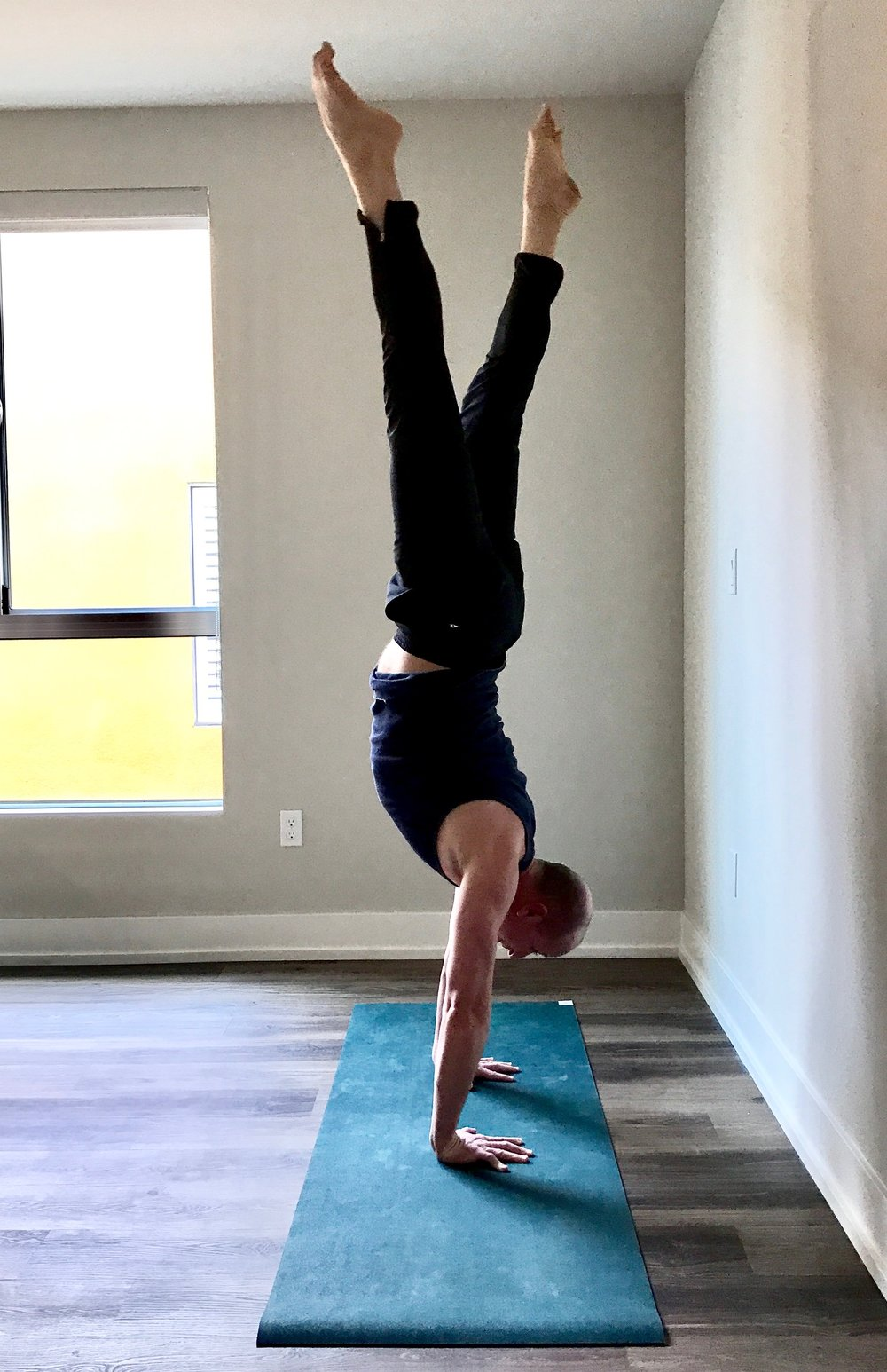I have been teaching yoga for a decade, and I have a little secret. I can't execute handstand (Ado Mukha Vrksasana) in the middle of the room. Any good yoga teacher would tell me that I am not defined by one yoga posture. I agree. However, the mat is a metaphor for life. Technically I probably can do the asana because I can easily practice it at the wall. To fully express the asana away from it, I have to tumble and potentially make a fool of myself. I have to be willing to fall. In rural Montana I was the only boy who danced ballet.  At nineteen I deserted college to move to New York City with Broadway aspirations. By twenty-nine I had voyaged to Oklahoma City to become an Artistic Director of a regional theater.  And by thirty-seven I abandoned that very steady, comfortable life to return to New York City. I have taken lots of risks. I am now forty-five; there are bigger chances to take.  I find every distraction in the world to help avoid them. I watch TV. I sip booze. I over eat. I troll Facebook. I work out. I do anything to evade telling my truth and skirt creating work. As an artist brutal honesty is required. Sometimes it's not pretty. I want everyone to like me and therefore only present my best side. To be a brilliant creator, I have to display the ugly, boorish and unlikeable parts too. I have to confess to being stubborn and mean, scared and sometimes even depressed.  For many years I have generated art, but not great art. Mainly because I have been petrified of exhibiting my spiritual, creative warrior.  If I parade my heart creativity, I might fail and fall.  Like handstand, risk is a practice. Today I am inching away from the wall.  What is your greatest risk? How are you not being honest with yourself?