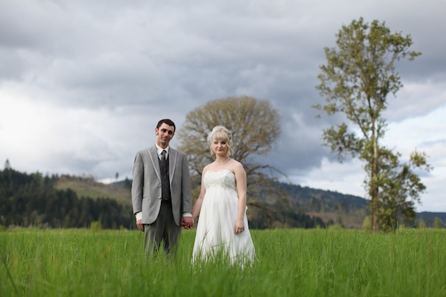 groom and bride in green field of grass
