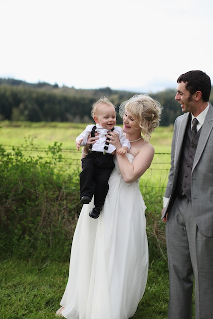 bride, groom and son at wedding