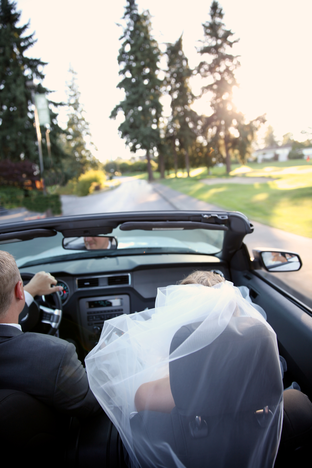 seattle wedding photographer sand point sandpoint country club golf course magnuson park engagement bride groom pictures reception ford mustand good bye exit car