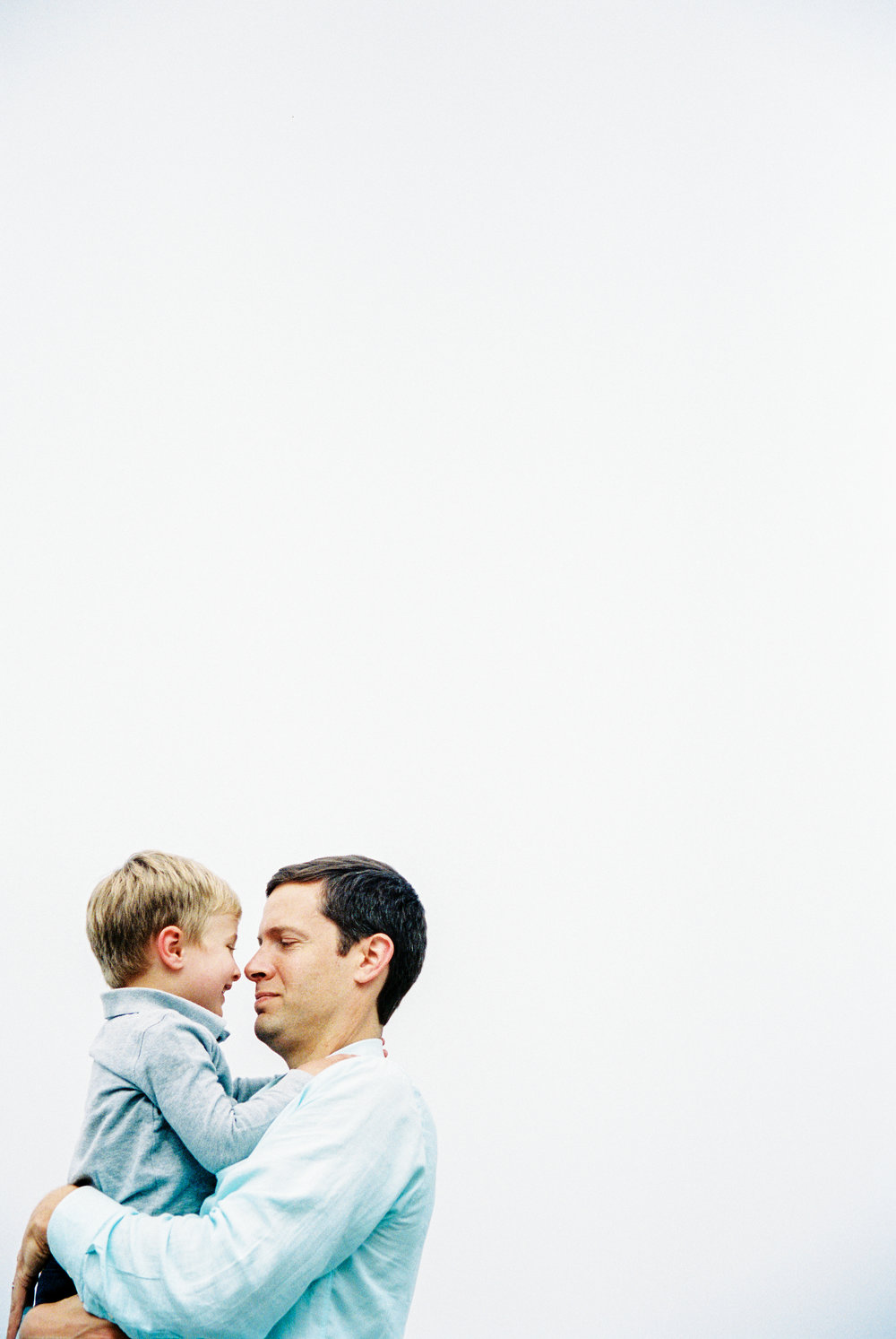 seattle family photographer photography film kids children baby newborn carkeek park ocean  sky father and son