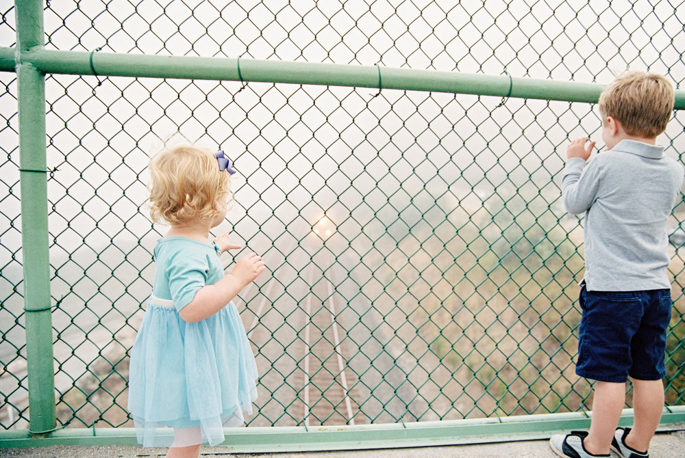 seattle family photographer photography film kids children baby newborn carkeek park ocean pudget sound little kids children father son mother daughter sister brother siblings train tracks
