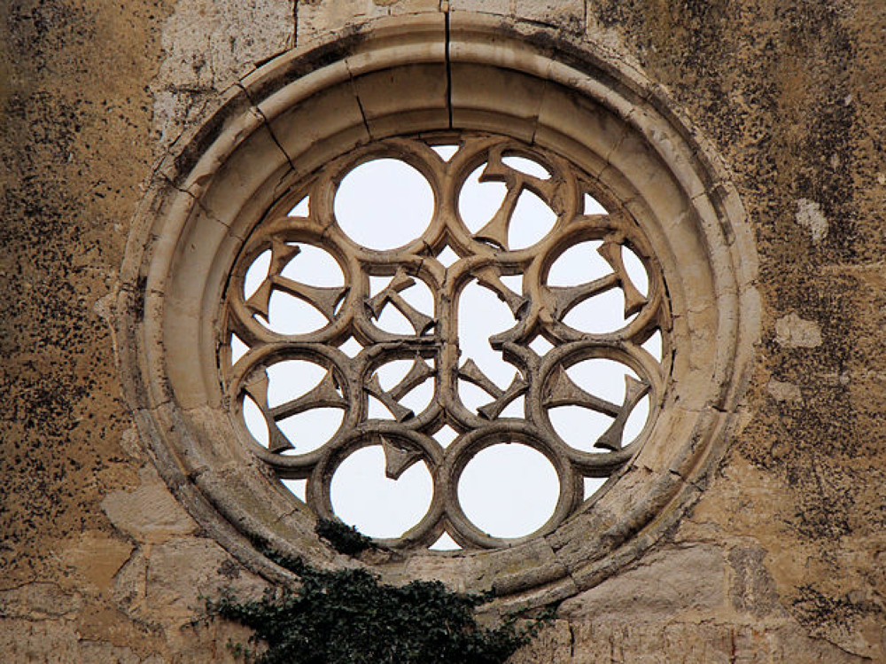 Convent de San Antón, Castrojeriz, Spain -  Caption: A window in the ruins of the 15th century Convent de San Antón, Castrojeriz, Spain. The window features the Tau Cross, adopted as the signal of St Anthony the Great, considered by early Christians to be a powerful healer. Photo credit: Bjørn Christian Tørrissen.