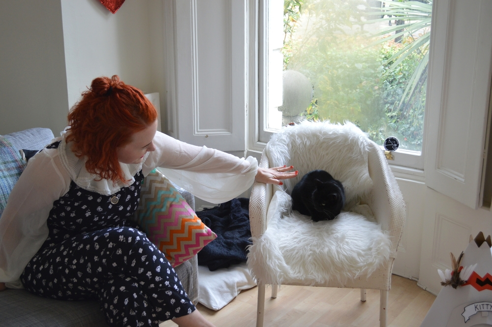 Louise with Kitty in her London flat