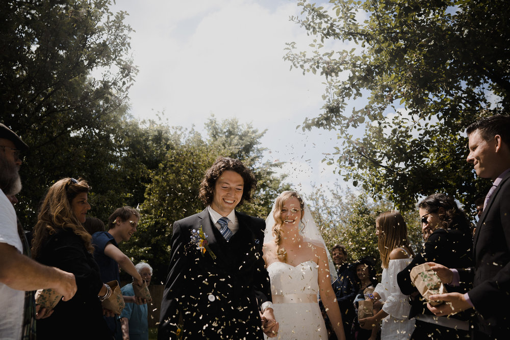 wedding photographer mark hadden amsterdam couple just married with confetti