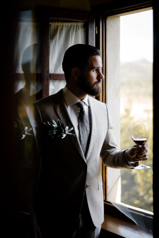 mark hadden wedding photographer amsterdam bride groom and red wine