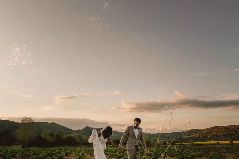 wedding couple walking in vineyard by mark hadden amsterdam and destination wedding photographer