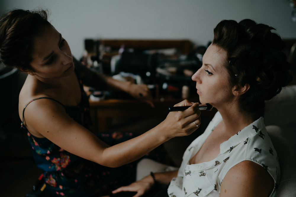wedding photography bride getting hair and makeup done