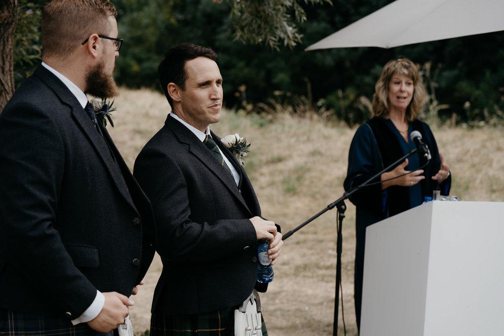 Portrait groom wedding ceremony by photographer Mark Hadden