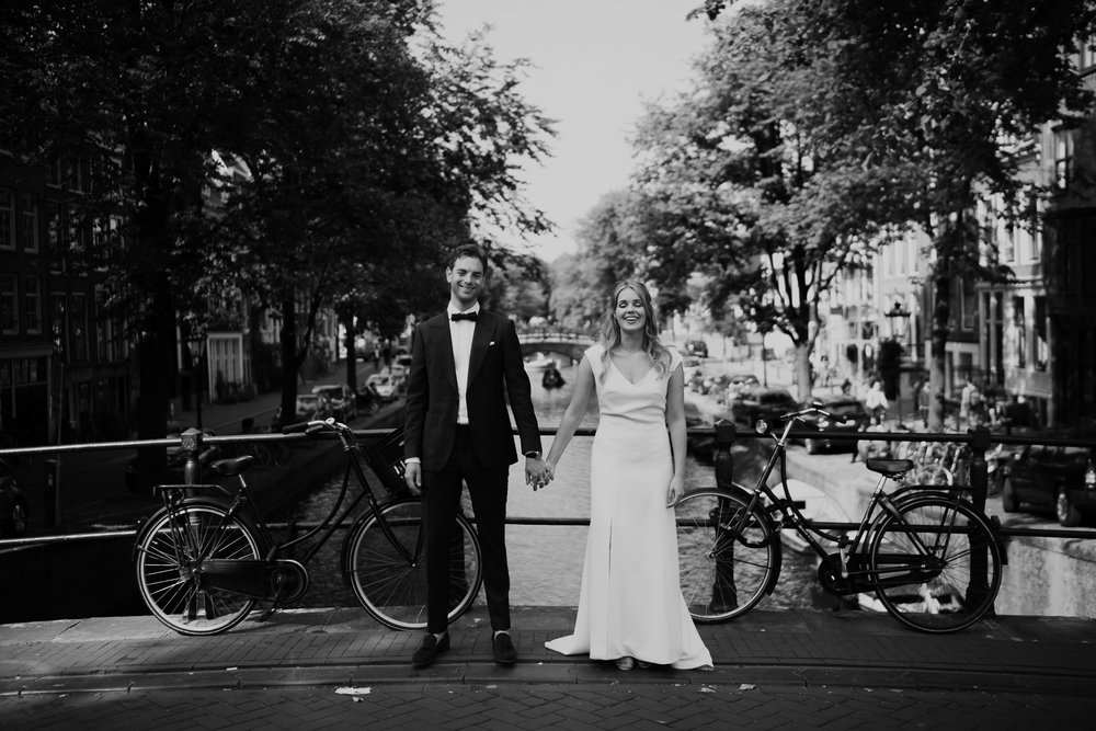 Couple getting Married in Amsterdam photo shoot at canals by mark hadden wedding photographer