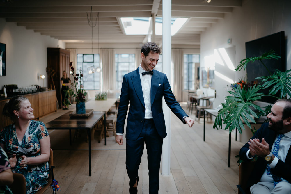 wedding photo of groom walking down the isle