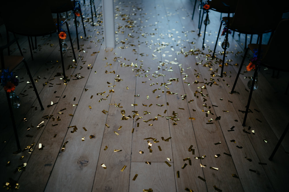 confetti on the floor after a wedding ceremony in amsterdam by wedding photographer mark hadden