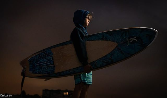 Portrait of Zack. Usually don't post images of family but couldn't resist the opportunity of photographing my grandson on the beach in Cali.  Recently acquired a top notch agent in LA. A real trouper with stiff cold breeze from the Pacific...translation, cold. #portraitphotography #surfing #justbeforedark #michaelbarleyphoto #texasphotographer @zackarybrooksofficial