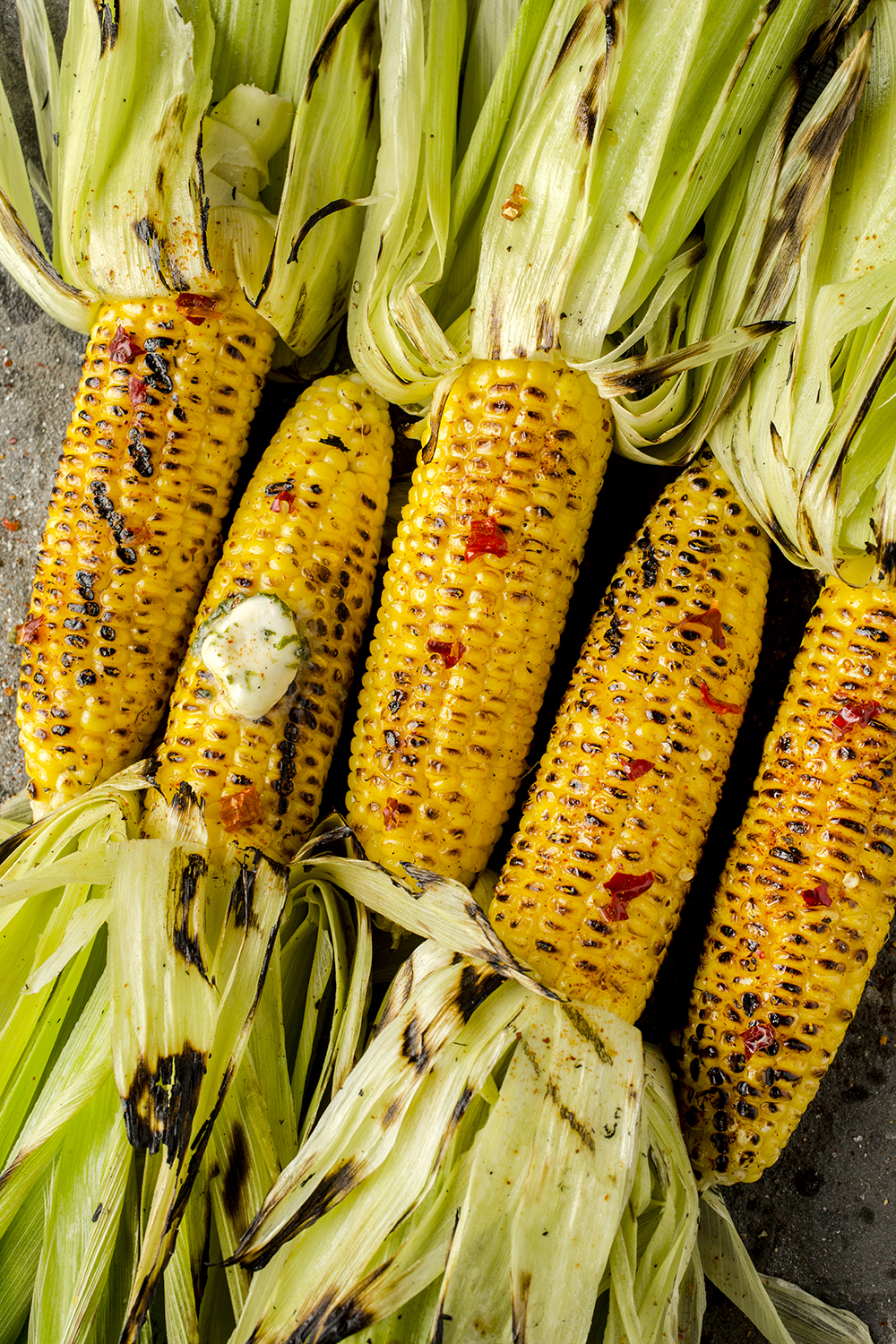 Roasted corn with red pepper and herb butter.