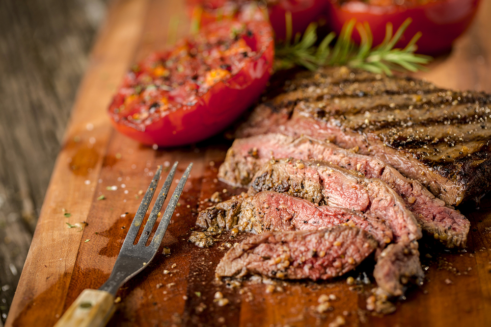 Flank steak with grilled tomatoes.