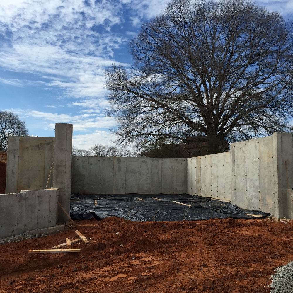 Basement walls are poured and forms removed.