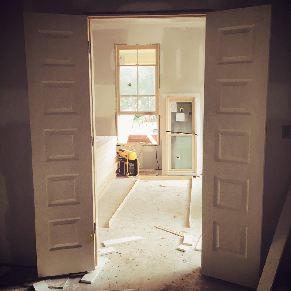 Double doors from master bath looking into bedroom
