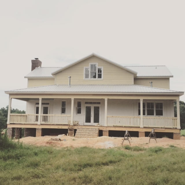 Farmhouse Back Porch With Railings and Brick Steps