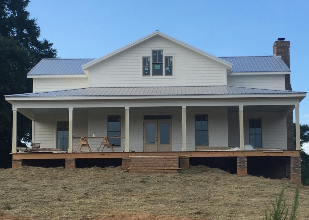 White Farmhouse with Tin Roof