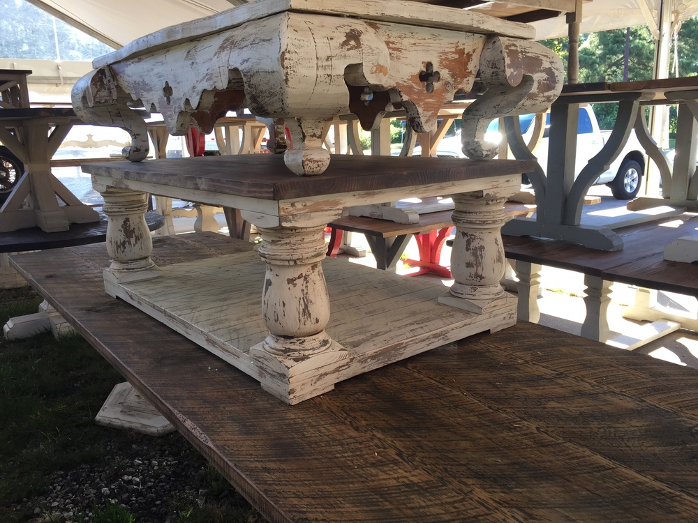 Gorgeous tables stacked outside of Atlanta's Own Scott's Antique Market.