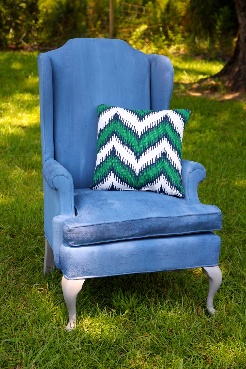 A chalk painted wing back chair in Sherwin Williams Naval.