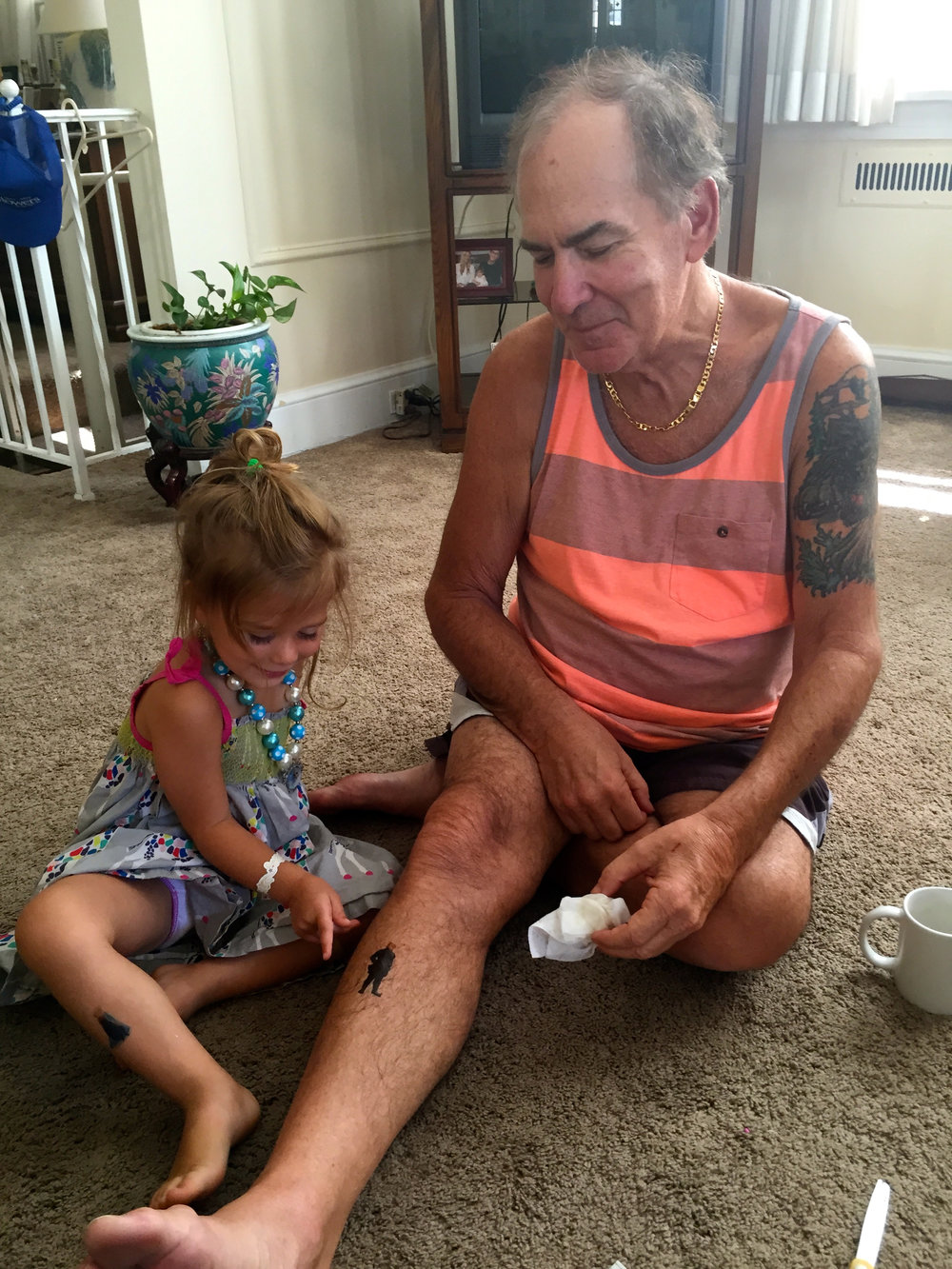 My father meets his 3-year-old granddaughter, and they bond over tattoos (2015).