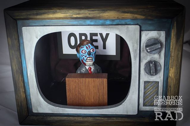 I finally put together a new project. There is a lot of different elements that went into making this piece and I'm stoked on how it turned out.  I sculpted and painted the figure and fabricated and painted the television, I even did some sewing on the curtain in the back. It features led lights and a suspended obey flag.  If this thing tickles your pickle, it is available for purchase. DM for details.  #gearboxdesigns #imake #fabricator #airbrush #supersculpey #sculpter #customtoys #toycommunity #horrorart #obey #theylive #woodworking