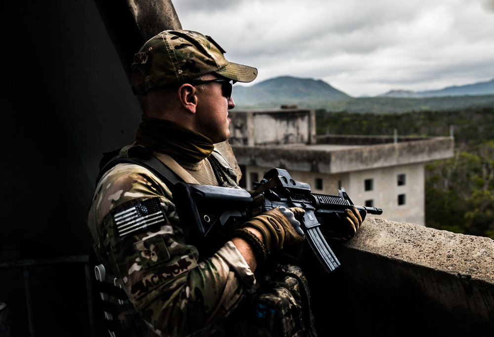 An airman provides security from a church tower during an exercise. Senior Airman Jackson, 18th Security Forces Squadron, Kadena AB, Okinawa, Japan.