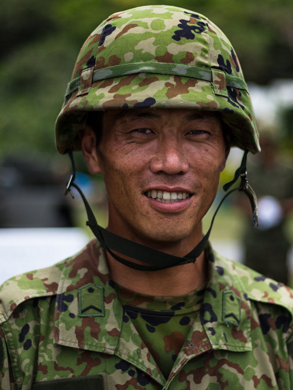 An unknow private with the JGSDF poses for a shot while at a local recruiting event. Private, 15th Brigade, Japan Ground Self-Defense Force, Naha AB, Okinawa, Japan
