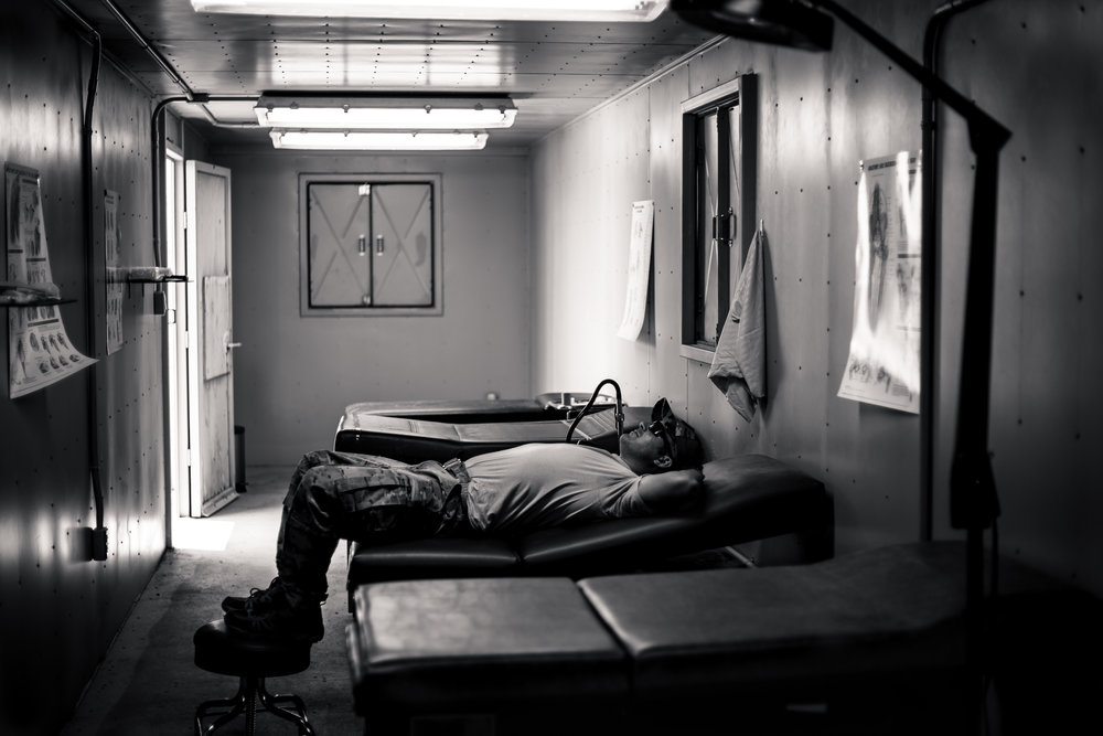 An SFG medic resting in the mock hospital. 353rd Special Operations Group, Camp Hansen, Okinawa, Japan